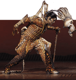 Man in armor lunging forward with skull mask